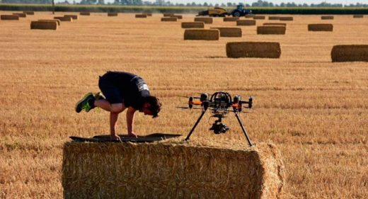 Chris WIlkinson from Upper Cut Productions doing yoga with drone